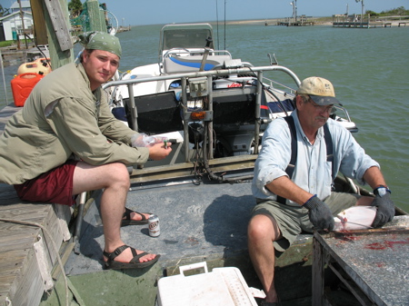 Myself and my father cleaning flounder off the coast of Texas